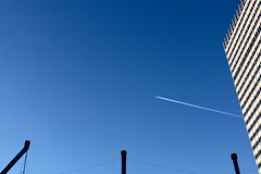 ChemTrail. (Urban Camper.) Tags: blue sky building water plane airplane pipe trail planes chemtrail plain vapor chemical airplain chemicaltrail