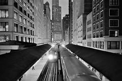 Madison Stop, Chicago II.  EXPLORE (rnx070) Tags: leica city blackandwhite bw chicago film skyline architecture night train 35mm cta trix summilux m6 chicagoskyline trix400 2 35lux