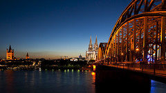 Cologne Cathedral at Nighttime (anadelmann) Tags: bridge blue sunset church water architecture night river germany deutschland wasser cityscape sonnenuntergang cathedral nacht dom kirche cologne himmel f100 kln bluehour blau alpha brcke fluss rhine rhein 900 blauestunde hohenzollern a900 greatstmartinchurch alpha900 anadelmann