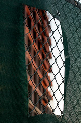 1-15-12 (austinjames24) Tags: red building green fence construction mesh frame torn tear 2012 365dayproject