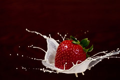 Strawberry Splash (Luvnish) Tags: canon rebel 50mm milk strawberry cream spoon splash f18 strobist t2i