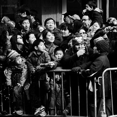 faces. (Vitaliy P.) Tags: new york city nyc people white black monochrome hat birds square nikon chinatown dragon faces photos candid year crowd chinese parade crop angry gothamist nikkor f28 masses barricade 2870mm yearofthedragon d80 13thannualchinatownlunarnewyearparadefestival