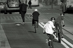 Yah, were in the street!  Whatcha gonna do? (Ian Sane) Tags: street city urban white black boys bicycle kids oregon portland ian photography bmx downtown do candid guys images skateboard skater dudes avenue motocross gonna 6th helmets yah sane the in were whatcha