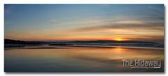Cold sunset panorama - Explore #453  03/02/12 (Simon Bone Photography) Tags: sea sky panorama cloud sun cold reflection beach silhouette reflections sand cornwall bitter gwithian wetsand cornishcoast cornishsunsets wwwthehidawaycouk canoneos7d canonef24105mmlf4