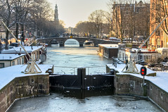 Icy Amsterdam (roevin | Urban Capture) Tags: bridge houses winter snow ice amsterdam season boats canal frozen cityscape thenetherlands center cover icy blizard korteprinsengracht eenhoornsluis