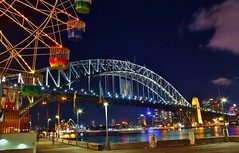 Sydney Harbour Bridge at night (Idiot4Hire) Tags: city bridge sky people reflection water colors beautiful night clouds reflections spectacular point lights colours view bright harbour sydney australian relaxing peaceful australia landmark icon calm luna coastal nsw stunning newsouthwales boardwalk ferriswheel lunapark operahouse funfair harbourbridge tranquil sydneyharbour milsons sydneyharbourbridge milsonspoint