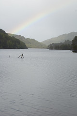 Scotland Loch Rainbow (albinobobman) Tags: trees lake storm water fog scotland rainbow pond colorful loch