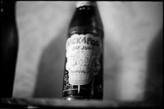 . (Ansel Olson) Tags: film restaurant virginia nikon dof bokeh juice south joy delta richmond roosevelt va f3 nikkor 3200 ilford 50mmf14 rva dogpatch kickapoo churchhill lilabner hairlessjoe lonesomepolecat