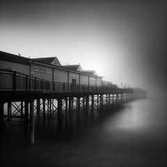 Glimmer (Andy Brown (mrbuk1)) Tags: ocean longexposure light shadow seagulls mist seascape reflection water fog architecture sunrise dark square dawn mono pier blackwhite mood glow atmosphere coastal devon teignmouth neutraldensity