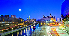 Moon Burst Over Ottawa (Shutter Nutty) Tags: morning blue moon ontario canada horizontal night buildings outside early canal downtown centre ottawa arts parliament center congress national chateau laurier rideau