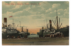 Foreign Ships in Galveston Harbor, Galveston, Tex. (SMU Central University Libraries) Tags: industry docks coast texas gulf ships cotton bales harbors