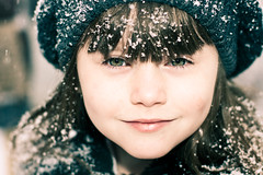 New snow! (Kilkennycat) Tags: winter snow girl canon snowflakes child eyelashes 50mm14 greeneyes 500d t1i