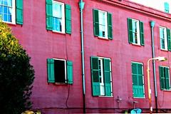 Houses of the Holy (TheGentlemensClub) Tags: blue windows light red house building tree water lamp colors intense louisiana bright neworleans culture frenchquarter shutters stains riverfront gutter saturate