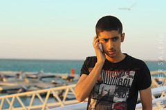 CALLING (Bshaier Saleh) Tags: blue boy red sea sky white black water canon person 50mm blackberry jed someone jeddah bb saudiarabia 2012  ksa saleh somebody lool 1433       jiddah         thul  d1000   1000d    canond1000    bshaier
