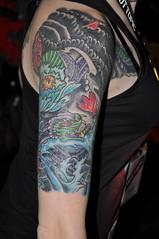 A Dragon Tattoo for 2012 (buddhadog) Tags: female arm tattoo hottopic governorsquaremall tallahassee dragon 500vu 100vu 1000vu d90 2000vu 2000