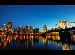 Pittsburgh -A Beautiful Dust- (Yohsuke_NIKON_Japan) Tags: longexposure bridge sunset water architecture night river nikon pittsburgh waterfront sigma bluesky pa nightview dust magichour 10mm robertoclementebridge bluemoment alleghenylanding andywarholbridge  d300s