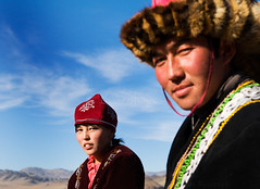 MONGOLIA (BoazImages) Tags: life portrait horses mountains men love hat costume clothing couple asia faces traditional culture hats lifestyle mongolia tradition centralasia kazakh grasslands nomads mongol nomadic altai abigfave boazimages