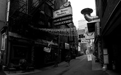 printers alley (Paul Nicholson) Tags: city urban blackandwhite bw panorama white black monochrome sign skyline architecture bar club buildings hotdog dance pub alley nikon bars theater downtown cityscape play tn nashville angle meetup metro tennessee wide panoramas tourist photowalk clubs hotdogs brass stable showgirls stitched painters printers myfavs greyscale dx municipality bna d90 landscapesarchitecture