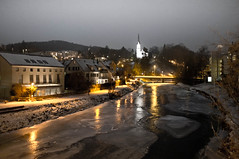 Winter on the river Sihl (cheeni) Tags: bridge winter orange white ice church night river stars landscape switzerland streetlight silence icefloes lamplight riverbank sihl