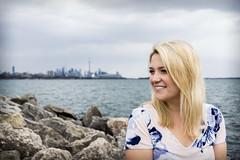 Sitting by Lake Ontario (MEL2YYZ) Tags: city portrait urban toronto girl rocks sony katie cities babe etobicoke alpha lakeontario six pearson tdot yyz parklawn thesix a6000