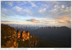 The Three Sisters in the Blue Mountains ( Mark Sunderland www.marksunderland.com) Tags: travel sunset rock landscape nationalpark rocks dusk australia bluesky bluemountains valley threesisters newsouthwales outlook overlook viewpoint touristattraction katoomba pinkclouds rockformation echopoint jamisonvalley eucalyptustrees