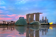 Gardens By The Bay (Kenny Teo (zoompict)) Tags: blue light sunset sea sky cloud seascape news reflection building tourism water beautiful skyline architecture night sunrise canon wonderful lens landscape photo yahoo google scenery photographer waterfront view walk wave tourist casino best getty wanted kenny singaporeriver gardensbythebay marinabaysands zoompict eos5dmark2 kennyteo singaporelowerpiercereservoir