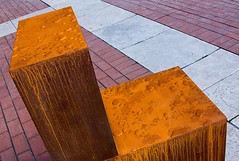 Witness, by Antony Gormley (commissioned by English PEN), British Library, London (chrisjohnbeckett) Tags: sculpture orange art rain pen chair rust seat politics oppression writers castiron piazza britishlibrary witness antonygormley londonist canonef24105mmf4lisusm chrisbeckett