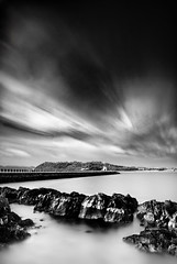 Mount Batten (Explored on 14/12/2011) (paulwynn-mackenzie.co.uk) Tags: longexposure sea bw mist seascape nature clouds photoshop photography pier seaside nice movement rocks waves quiet sony relaxing kitlens clarity a33 structure walkway processing alpha dslr vignetting tones vignette minimalist mountbatten slt pp lightroom postprocessing