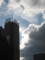 Clouds and Sunlight Attacking the New New York Times Building 2290 (Brechtbug) Tags: new york city nyc roof cloud building tower sunshine skyline clouds cityscape top manhattan midtown times attacking 2011 12172011