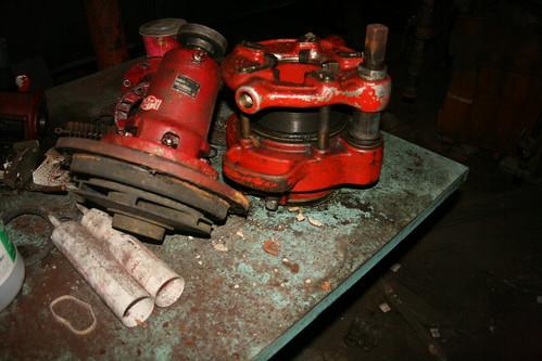Massive pipe cutter in storage room