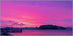 sunrise (kimbenson45) Tags: pink red sea sky lighthouse color colour water port sunrise landscape rocks purple sweden coastal lysekil