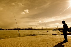 Contemplating fish (drcptyler) Tags: old sunset sea man portugal sepia river fishing lisbon cobbles