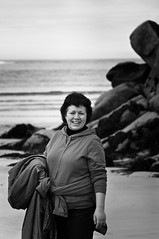Birthday Girl (The Kitchens) Tags: birthday ireland sea woman beach smile contrast zeiss pentax coat mother jena 135 donegal ulster 135mm lightroom k7 blankcandwhite