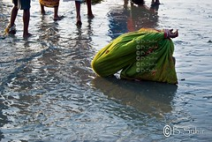 For the sake of Virtue... (subirbasak) Tags: woman india beach ritual pilgrim rites westbengal subirbasak traditionalritualofindia gangasagar2012 femalepilgrim