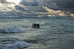 passing storm, whitefish bay, michigan (twurdemann) Tags: usa seascape storm weather clouds waves michigan horizon greatlakes pilings whitefishbay lakesuperior whitefishpoint northernmichigan upperpeninsular 49768
