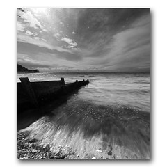 Totland Groyne Vertorama #2 (welding glass) (s0ulsurfing) Tags: ocean uk longexposure blue sea england sky blackandwhite bw cloud english praia beach nature water clouds composition canon island photography grey mono bay coast mar scenery skies natural britain wide shoreline blues wideangle monotone coastal photograph shore vectis isleofwight vista coastline british isle groyne channel englishchannel wight headland lamanche 10mm totland 2011 weldingglass sigma1020 totlandbay s0ulsurfing coastuk vertorama
