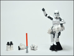 I TOLD you not to play with the lightsaber... (Greg 50) Tags: starwars lego stormtrooper lightsaber punishment spanking sabrelaser fesse