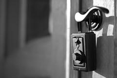 Surplus (dvsmith) Tags: door blackandwhite bw sunlight monochrome canon eos dof durham bokeh northcarolina depthoffield doorknob nocrop economy doorhandle generalelectric lockbox recession foreclosure ef50mmf14usm searchable keybox emptyhouses 1dmarkiii buyersmarket surplushomes