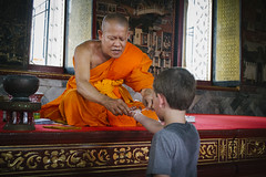 Sai Sin (tylerkingphotography) Tags: city travel boy orange youth lens thailand photography nikon southeastasia photographer outdoor bangkok buddha kingdom monk buddhism indoor fortune explore backpacking luck thai bracelet kit 1855mm traveling amateur watpho watpo templeoftherecliningbuddha saisin rattanakosinisland phranakhon sacredthread watphrachetuphonvimolmangklararmrajwaramahaviharn d3100