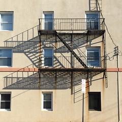 A morning walk home. (Elizabeth Francesca Perone) Tags: morning windows sun building architecture shadows squareformat fireescape rauls longshadows