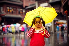 A little girl with yellow umbrella (snowpine) Tags: china street portrait people cute rain kid rainyday bokeh candid chinese streetphotography streetportrait littlegirl colourful nanjing chinesegirl