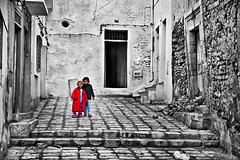 Friendship - 1 (Ben Heine) Tags: poverty life street houses windows girls light portrait people cute home smile childhood architecture portraits walking children happy hope friend mood doors cityscape friendship tunisia pavement homeless perspectiv
