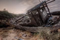 Abandoned Boat (Vasilis Mantas) Tags: sunset sea summer bw art abandoned beach canon island photography boat ship 110 greece macedonia nd l hdr 1740 chalkidiki 500d 2011 amouliani vmantas vmantasphotography