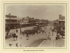 Street parade featuring bands, in Bourbon Street, Bundaberg (State Library of Queensland, Australia) Tags: horses buildings day queensland years crowds streetscenes processions statelibraryofqueensland slq bundabergqueensland statelibraryofqueenslandnew
