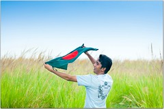 ... (Ehtesham Khaled [www.ehteshamkhaled.com]) Tags: boy sky grass freedom march fly war december day flag young victory celebration dhaka bang 16th liberation bangladesh bangla   bijoy shadhinota dibosh             gettyimagesbangladeshq3 muktijudho gettyimagesbangladeshq12012