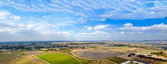 Panoramic view of Irvine from the air balloon (Kartik J) Tags: california park sky panorama usa clouds day clear orangecounty irvine kartik sonydslr sonyalphadslr sal18250 sonydslra500 kartikjayaraman greatocpark
