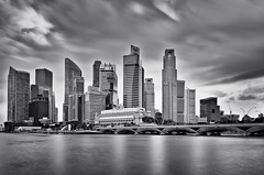 Singapore Skyline (Sebastian (sibbiblue)) Tags: camera longexposure water skyline nikon singapore cbd centralbusinessdistrict 18105 fullertonhotel esplenade marinabay daytimelongexposure neutraldensity nd110 altitudebar nikond7000