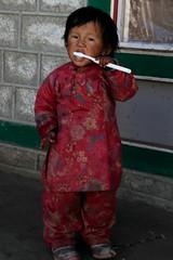 Little Girl Brushing Her Teeth (SamHawleywood) Tags: travel bridge nepal yak people india mountains color colour nature smile smiling trek river fun temple colorful faces bright spirit walk smiles buddhism tajmahal hike gla