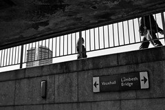 A level below (Gary Kinsman) Tags: above bw london sign contrast underpass subway blackwhite candid streetphotography highcontrast streetlife canon350d below railing canonrebelxt lambeth 2007 se1 millbanktower albertembankment canon1855mm ronaldwardandpartners