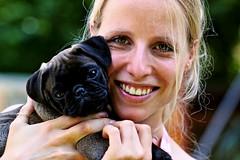 brown beauty (hellbunt by anja feßer) Tags: dog brown cute green smile eos dof sweet hund blond braun frau pugs lächeln mops süs 550d frauchen tiefenunschärfe mithund